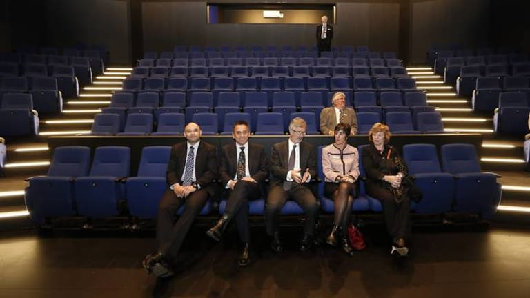 Stephen Gwilliam, left, John Stenhouse, Minister for Education and Training Chris Bourke, Belinda Bartlett, Kerrie Grundy, and George Palavestra, rear, test the seats in the new $9.35 million Canberra College Performing Arts Centre.