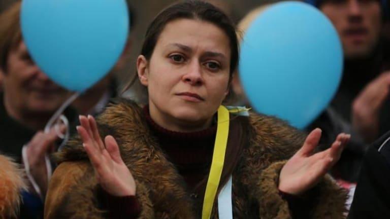 Yula Yavorska listens to speeches at Shevchenko Park during a pro-Ukrainian rally, in Simferopol, Crimea.