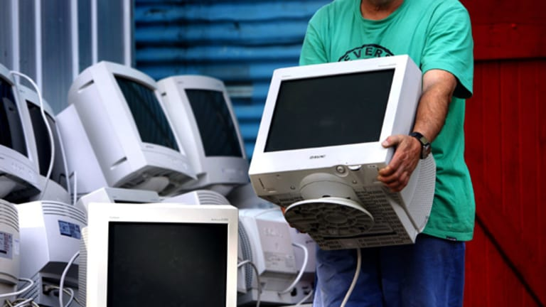 Computer monitors being stored ready for recycling at a Sydney depot.