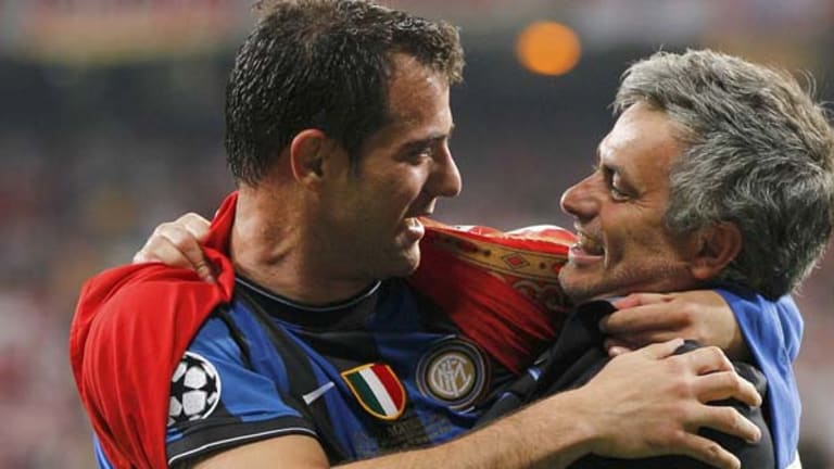 Inter Milan's manager Jose Mourinho hugs Dejan Stankovic after their Champions League final victory.