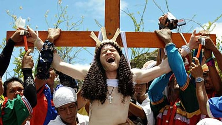 Australian 'John Michael' has his hands nailed to the cross in an imitation of Christ's death as part of Good Friday rituals just outside Manila.