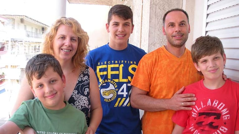 Cultural change: Greek Australians. Kathy Lekkas and Oresti Sioutis (above) with their children Lefteri, Spiro and Michael at home in Thessaloniki.