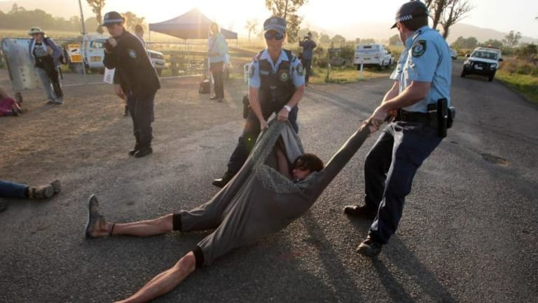 Demonstration gets out of hand: Police seize a protester.