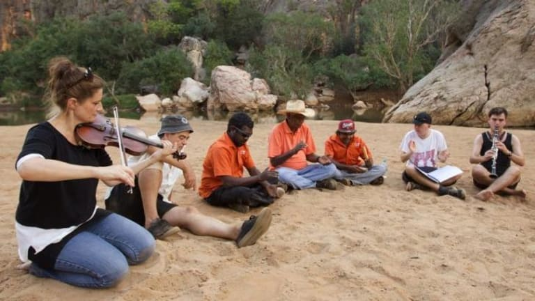 Sydney Symphony Orchestra members gather at Windjana Gorge to practise a piece.