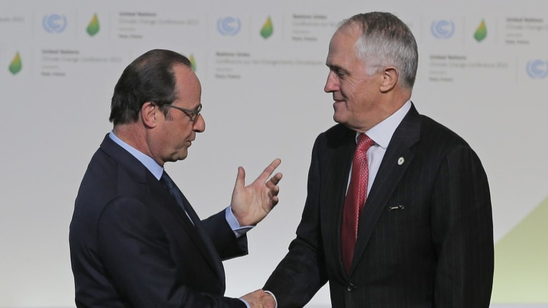 Francois Hollande greets Malcolm Turnbull as he arrives for the UN climate conference.