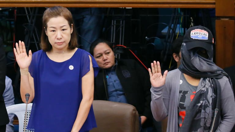 Choi Kyung-jin, left, the widow of South Korean businessman Jee Ick-joo, and their former housekeeper Marissa Morquicho take their oaths at the start of the Philippine Senate probe into his killing.