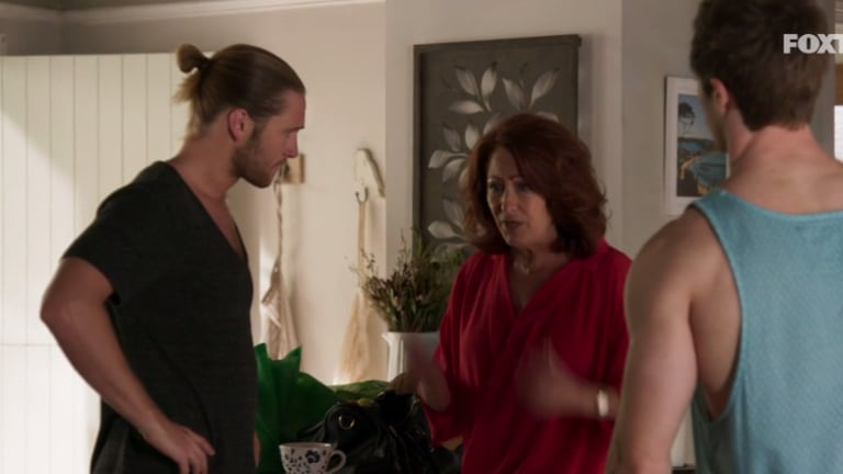 Irene (Lynne McGranger) in a tense situation with Ash (George Mason, left) and Nate (Kyle Pryor) in <i>Revenge</i>.