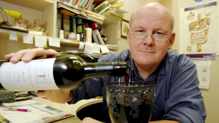 Philip Norrie pours a glass of resveratrol-enhanced wine.