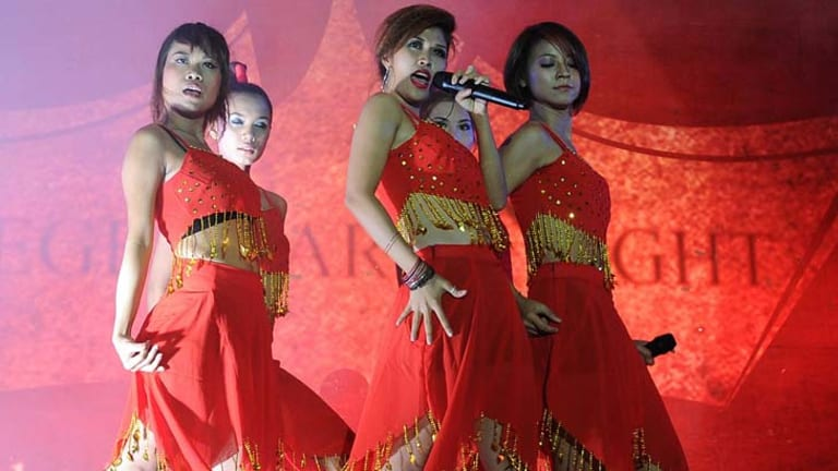 Members of the Me N Ma Girls band perform in Rangoon.