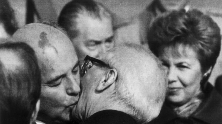 Mikhail Gorbachev and Erich Honecker greet each other in East Berlin in 1989.