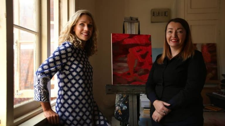 Artist Maz Dixon (right) in her Bondi Beach studio with Emilya Colliver, the director of The Other Art Fair, a new affordable art fair.