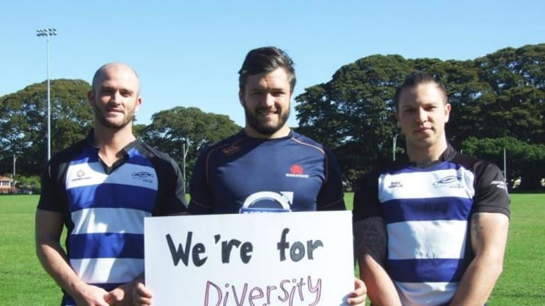 Support: Adam Ashley-Cooper stands with two members of the Sydney Convicts rugby club .