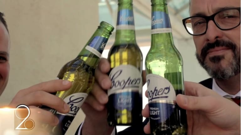 The video is laced with lingering shots of Coopers beers.