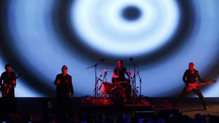 U2 perform at the Apple launch on September 9, 2014.