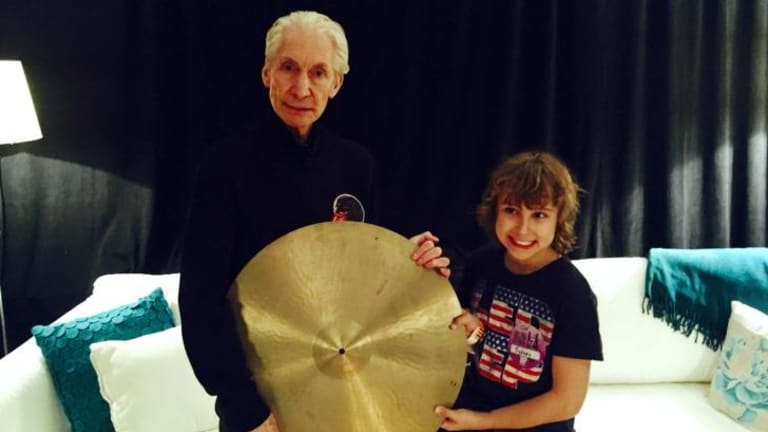 The Rolling Stones drummer Charlie Watts with fan Jagger Alexander-Erber, who gifted his rock idol with  a cymbal once owned by Jackie Dougan.