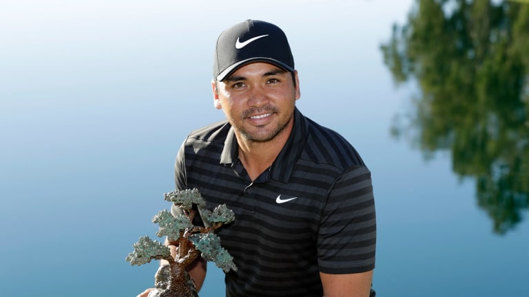 Lofty goal: Jason Day holds the trophy after winning the Farmers Insurance Open.