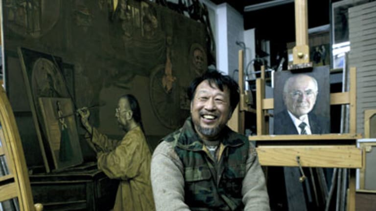 Portrait of the artist ... Jiawei Shen in his Bundeena studio yesterday with one of his studies of John Howard, and the official portrait, below.