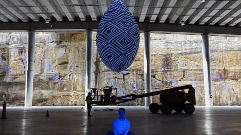 Andrew and his work displayed in the huge space at Brrangaroo.