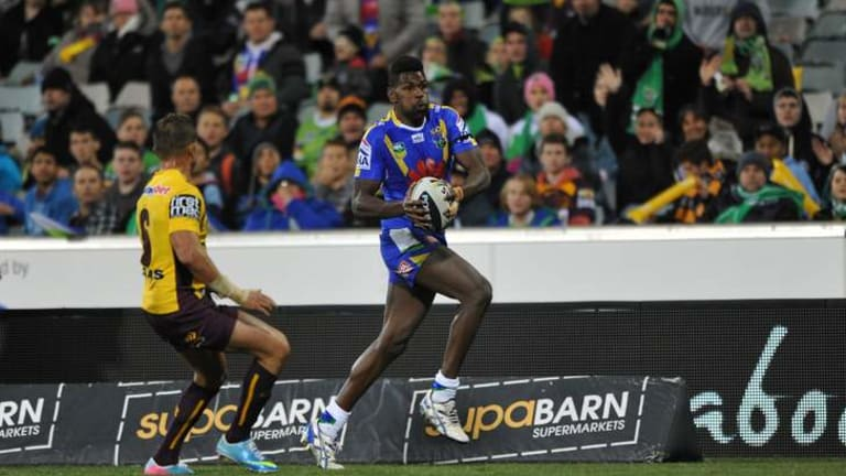 Edrick Lee heads for the try line during Monday's clash with the Broncos.