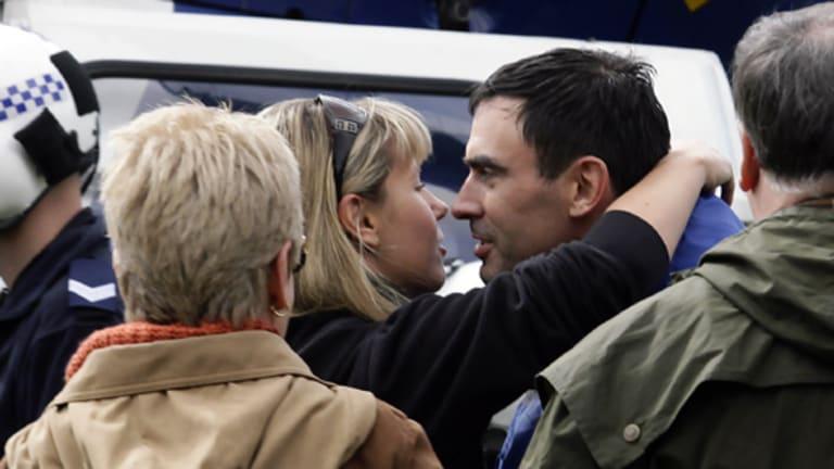 Tim Holding with his girlfriend, Ellen Whinnett.