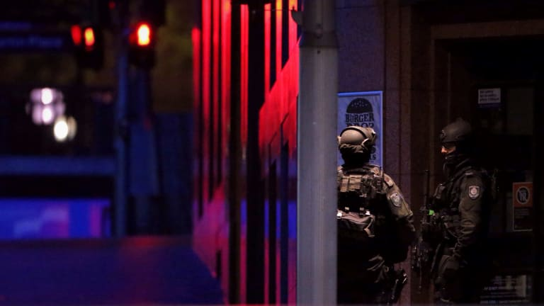 Tactical operations unit police keep watch before the first loud noise was heard.