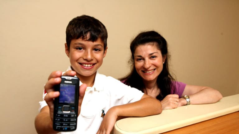 Luke Gaffney of Double Bay with his mobile phone, left, and his mother Irene.