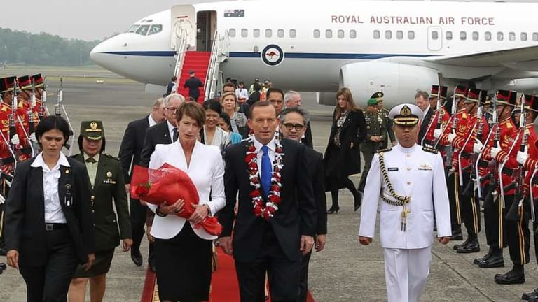 Ruffled feathers, at least among the media: Prime Minister Tony Abbott and his wife Margie on arrival in Jakarta last Monday.