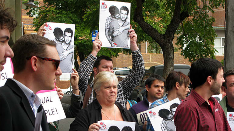 Protesters gather outside Adshel's Fortitude Valley headquarters this week before the ad was reinstated.