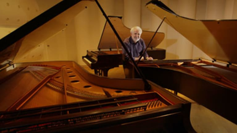 Mother of all grands ... Wayne Stuart of Stuart & Sons leans on the mega-grand in his Newcastle workshop. The piano has 102 keys,  14 more than normal pianos.