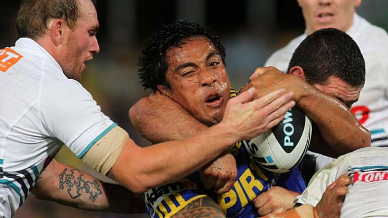 Body on the line ... Eels cult hero Fuifui Moimoi takes a lot of stopping.