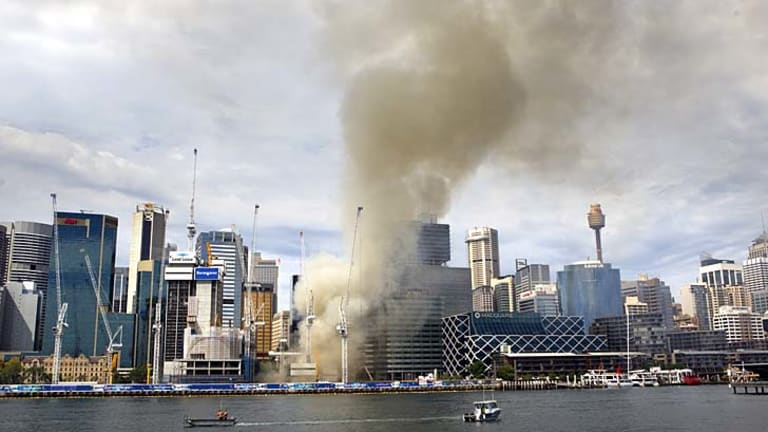 Fire breaks out: Smoke billows from the Barangaroo construction site on Wednesday afternoon.