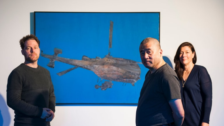 Painting titled 'Flying Machine' is the centrepiece of 'Zhang Peili: from Painting to Video' exhibition at the Australian National University. Pictured with co-curators Olivier Krischer and Kim Machan.