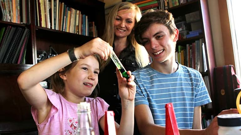 Emotional decision: Sydney mother Lindy Hadges with Ruben, 15, and Odette, 8. Ms Hadges is educating her five children at home as she believes in a more ''organic, fluid'' style of learning.