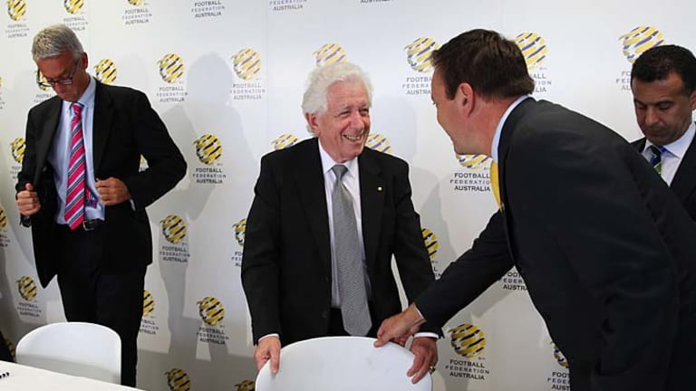 Winners are grinners ... FFA chairman Frank Lowy can't disguise his delight.