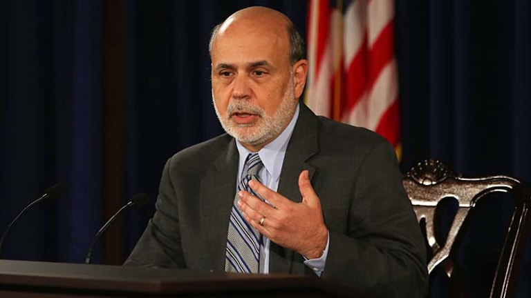 Staying the course: US Federal Reserve Chairman Ben Bernanke announces the surprise decision..