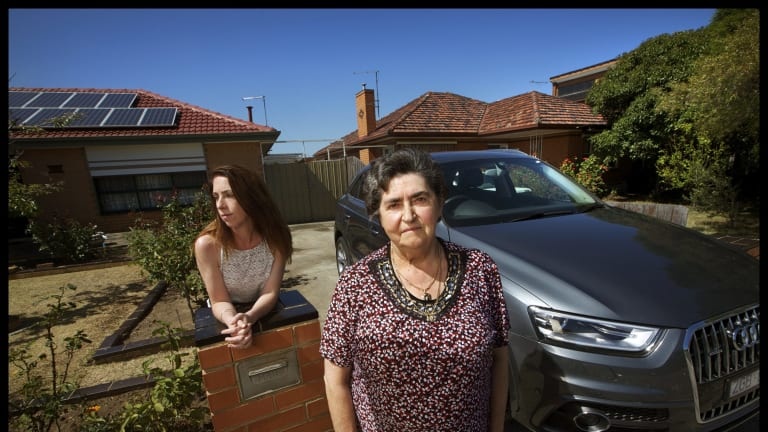 Rosa Bogar (left) pictured with her son Attila Bogar's friend Carly Heard and Attila's car which was found abandoned near Wollongong.