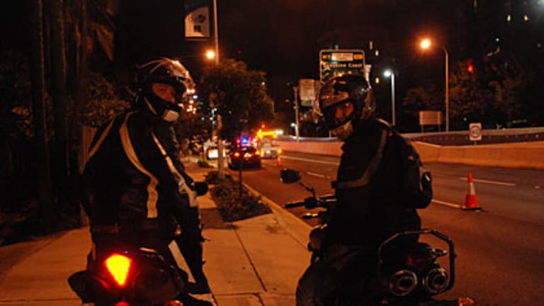 Motorbike rider Dennis Markwell (right) and Daniel (left) were the first motorists to use the Clem7 tunnel's Shafston Avenue entrance as it opened to traffic.