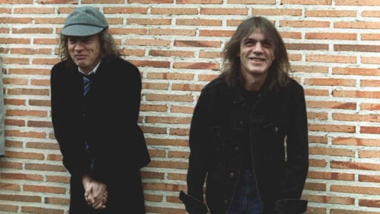 Malcolm Young, right, with his brother Angus, pictured here in 2000.