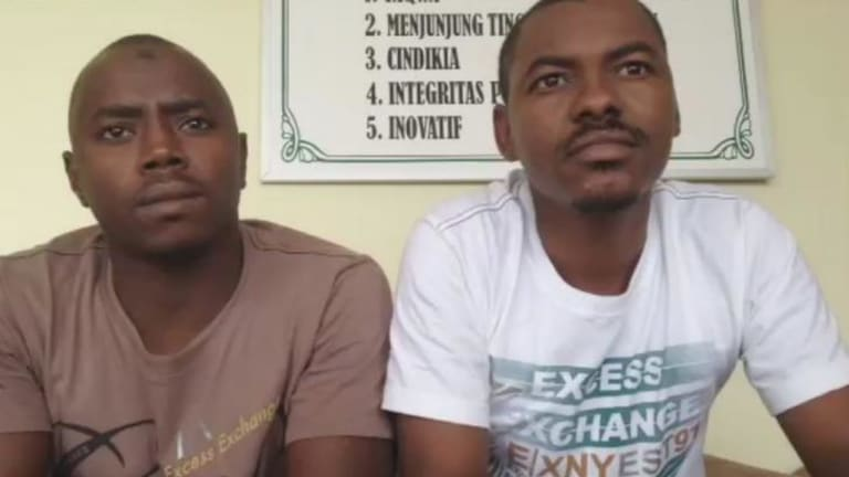 Translator Yousif Ibrahim Fasher, right, claims  three asylum seekers had their hands deliberately burned by the Australian navy during its second operation to tow back an asylum vessel to Indonesia in January.