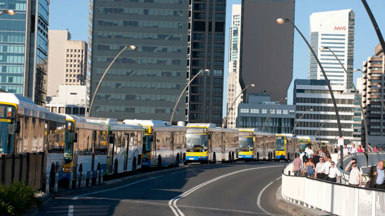 Buses queue along the Victoria Bridge at peak hour.