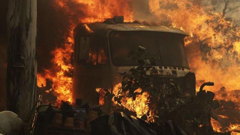 A truck catches fire.