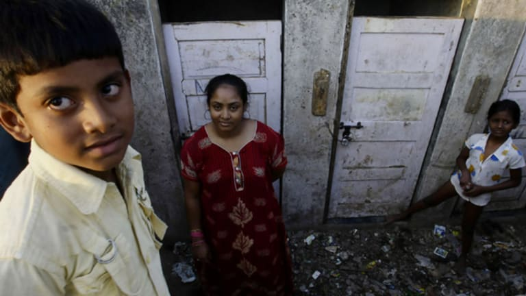 Shah Rukh Munshi, 11 (left), who acted in  Slumdog Millionaire  and his mother, Regina Munshi, 28, near their slum home.