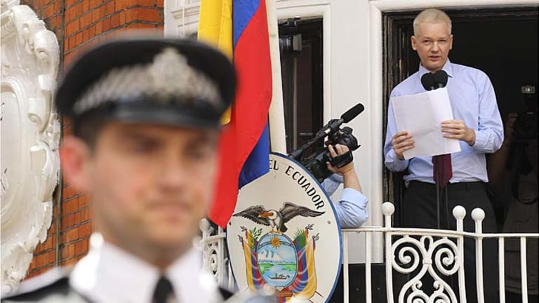 """""""End the witch-hunt"""" ... WikiLeaks founder Julian Assange makes a statement from the balcony of the Ecuador embassy in London."""