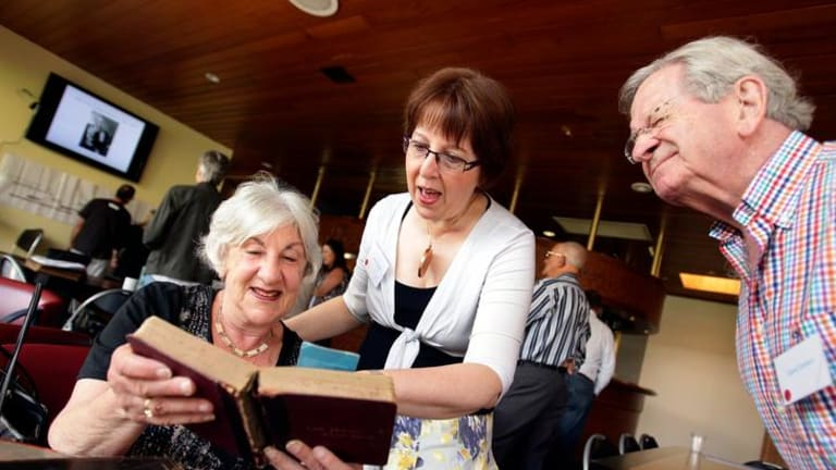 The Solomon family reunion in Caulfield, Melbourne where Beverley Gorr, Jenny Cowan and  David Graham look through some old cooking books.