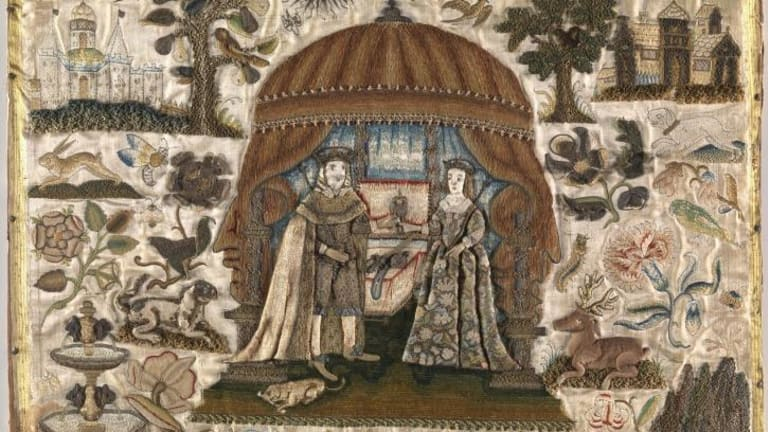 Details of a panel of King Charles I and Henrietta Maria (mid-17th  century) done by a 12-year-old girl. It is composed of silk, linen, paper, metal, pearls, coral, wood, and cotton wadding.