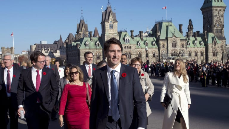 Prime Minister Justin Trudeau and his newly sworn-in cabinet ministers arrive on Parliament Hill in Ottawa.
