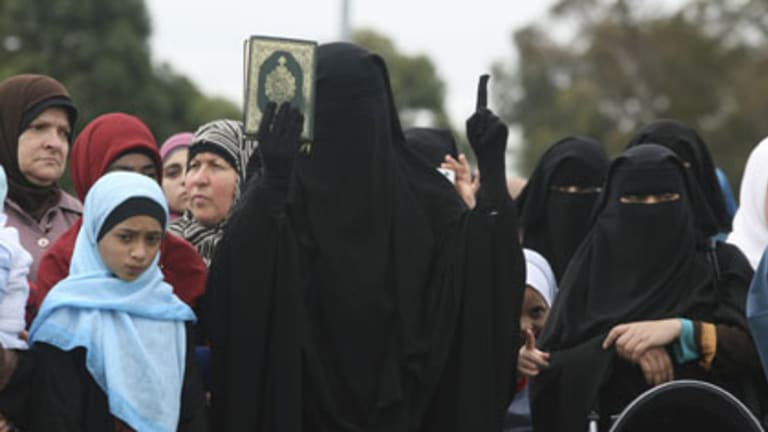 East meets west ... a woman addresses the rally in Lakemba yesterday. The crowd heard that more and more Western women are embracing Islam.