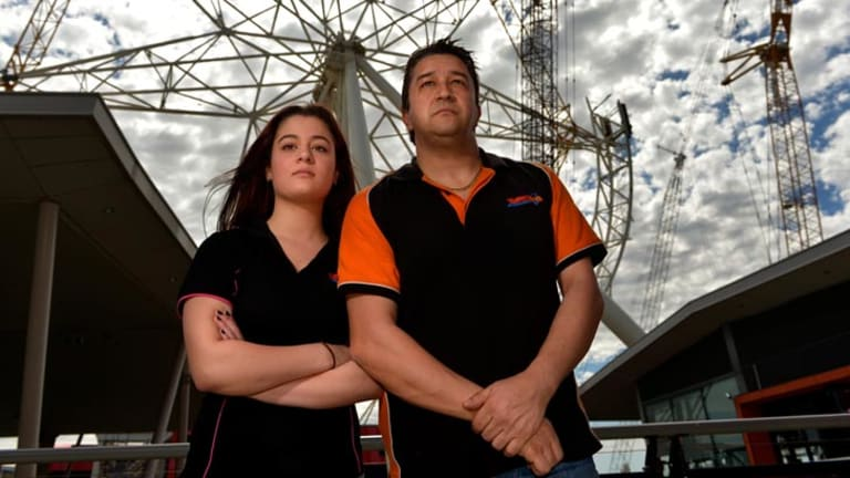 Chris Kalpis, owner of Tunzafun at Harbour Town, and assistant Elizabeth Cugliari are upset about constant delays in setting the Southern Star wheel back in motion.