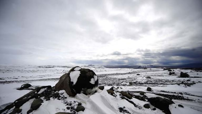 Volcanic boulders sit atop the Myrdalsjokull glacier, which is part of the ice cap sealing the Katla volcano, near the Icelandic village of Vik.