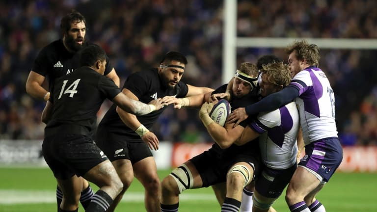 Time to regroup: New Zealand's Luke Romano is tackled by Scotland's Jonny Gray.